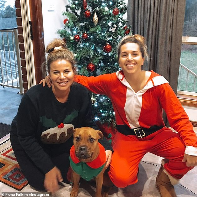 Festive!Last week, Fiona and her wife-to-be Hayley, 30, (right) smiled as they posed with their Christmas tree and pet dog