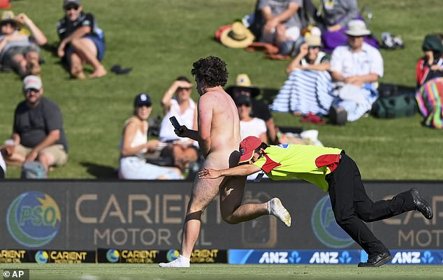 The streaker was finally brought to the ground by a security guard with a flying tackle