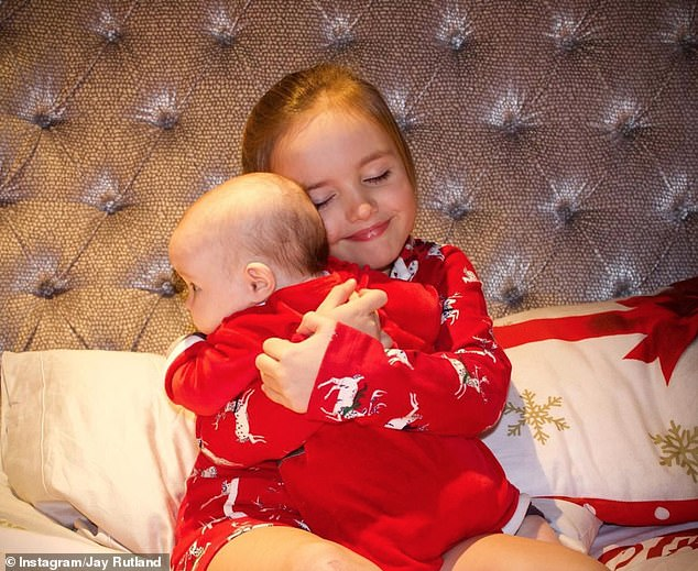 Christmas cuddles: It comes after Jay shared an adorable picture of Sophia cuddling her baby sister Serena over the weekend
