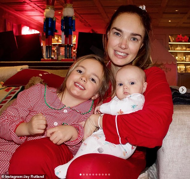 Doting mother: He also posted a series of snaps he said were his 'faves' from Christmas Day, including one of Tamara cuddling up to her two young children
