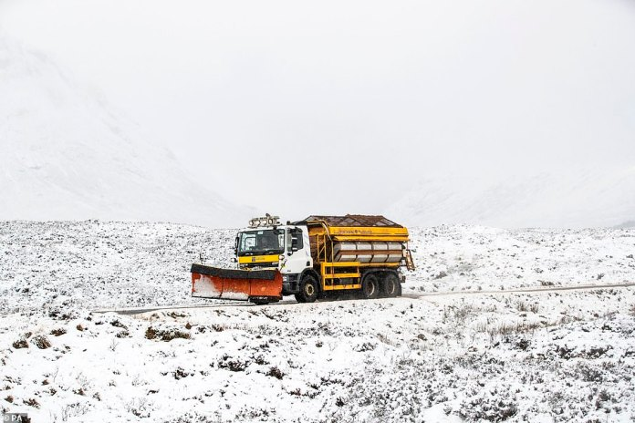 Snow is set to fall in the UK as the Met Office issues warnings across the country hours after Storm Bella hit. Pictured: A snow plough travels along the A82 in Glencoe, Scotland on Sunday
