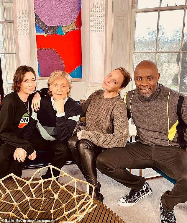 Quartet: Paul poses with daughters Stella and Mary alongside Idris ahead of the BBC interview