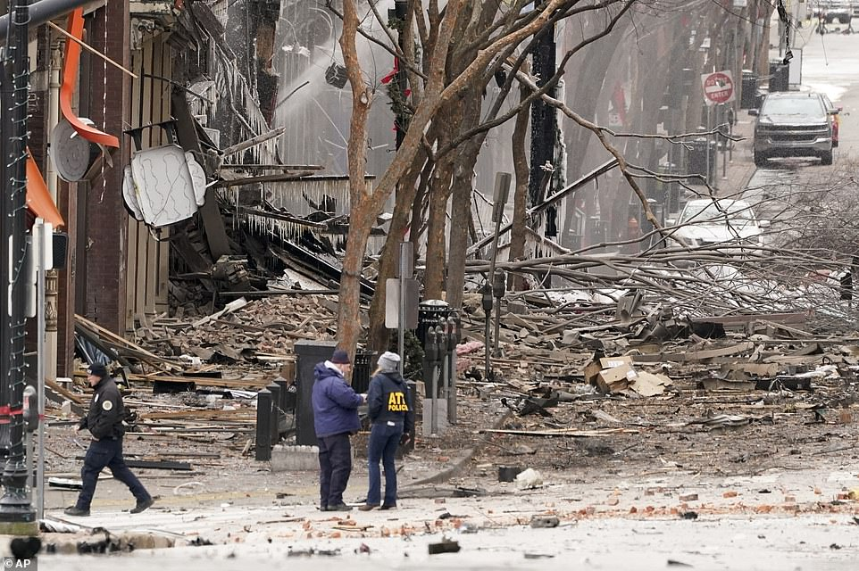 Emergency personnel work near the scene of an explosion in downtown Nashville on Friday