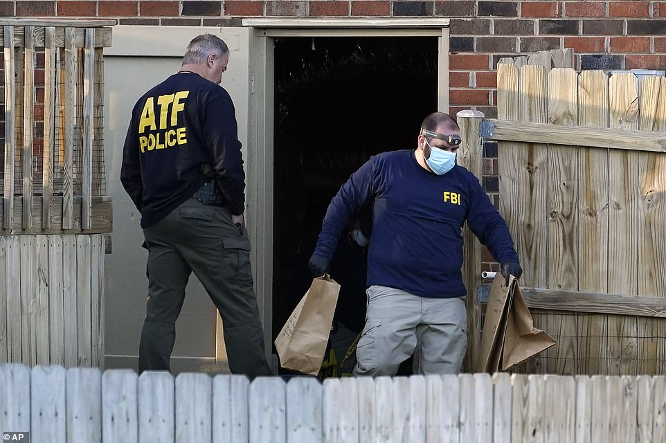 Investigators remove items from the basement of the home in Nashville, Tennessee, on Saturday afternoon