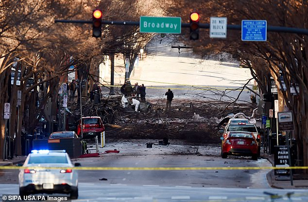 ATF and law enforcement members investigate the Christmas Day explosion that tore through downtown Nashville