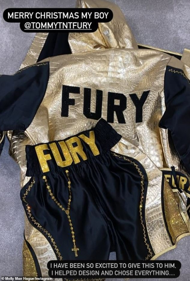 Stand out from the crowd: She also documented her Christmas gift to Tommy which consisted of personalised boxing shorts and a jacket, both in black and gold fabric