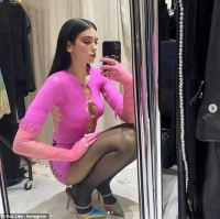 Dua Lipa flashes her cleavage in a cut-out pink dress after Christmas snaps with beau Anwar Hadid