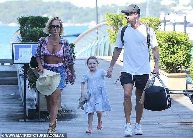 Michael Clarke, Kelsey Lee, five, and girlfriend Pip Edwards return from a day on Sydney Harbour