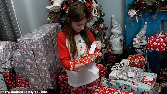 The Christmas video - showing mother Sue opening a 'massive' gift - also gave a glimpse of the family's piles of gifts that were under their huge tree