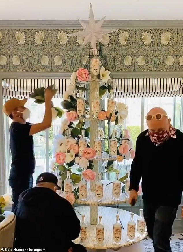 Oh vodka tree: She previously shared a time-lapse video to Instagram of the tree being constructed out of King St Vodka bottles - which is her brand, which she launched in November - and pink and white flowers