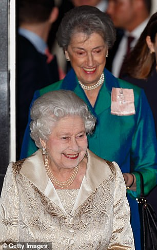 The Queen accompanied by her Lady-in-Waiting Lady Susan Hussey departs after attending the Gold Service Scholarship awards ceremony at Claridge's on February 16, 2016 in London
