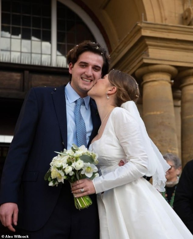 Sealed with a kiss:The bride designed her own dress, creating one with her signature square neckline, and complete with a matching jacket and trousers hidden under the skirt. Coco shared this photo taken by her father to mark the occasion