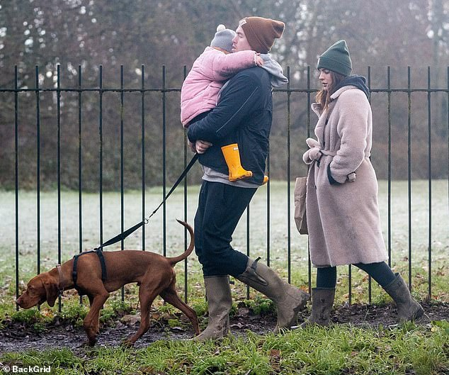 Here they come:Binky Felstead was joined by fiancé Max Darnton and her daughter India on Monday morning as she made her first appearance since confirming her second pregnancy
