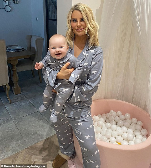 Danielle Armstrong and daughter Orla, six months, wear matching pajamas