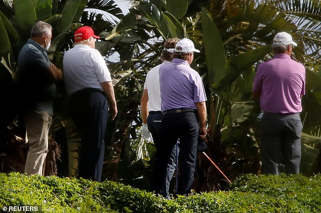 President Trump's public schedule notes he is working 'tirelessly' for the American people; above he's seen on his golf course