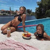Tammy Hembrow risks a wardrobe malfunction in a barely functional black bikini