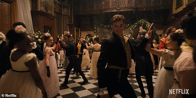 A grand ball is held in Bridgerton, where the two central characters meet. Pictured, actors twirl across the dance floor in Regency costume