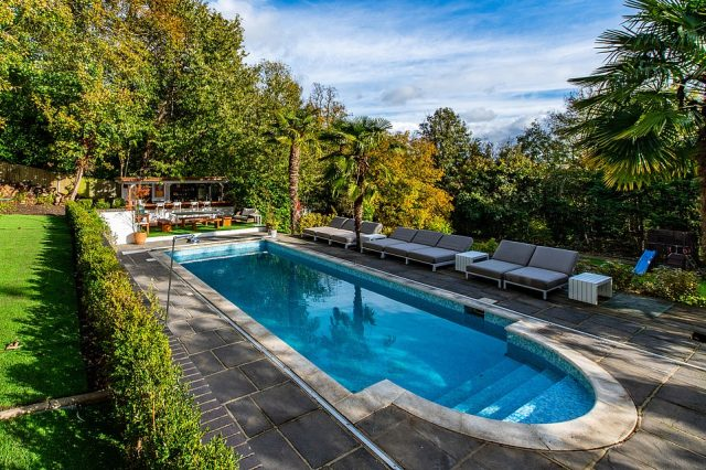 A step outside the expensive home also reveals a large garden that features a swimming pool and comes with a seating area which the couple said would be perfect for pool parties