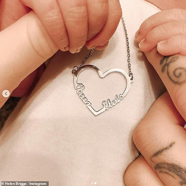 Bejewled:Helen also showed off some new jewelry, a heart pendant, with her son and daughter's names on it