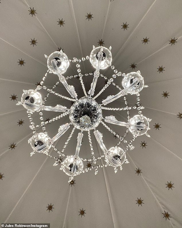 So pretty: A stunning outdoor chandelier was on hand to light up the canopy structure at night