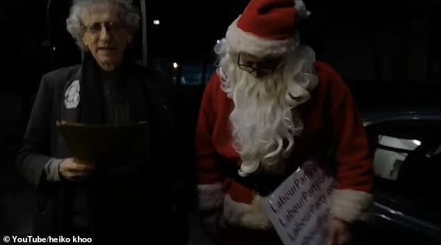 Piers Corbyn and a man dressed as Santa head to his brother Jeremy's house on Christmas Day to deliver gifts. The group of four is been accused of flouting Tier 4 restrictions by meeting up