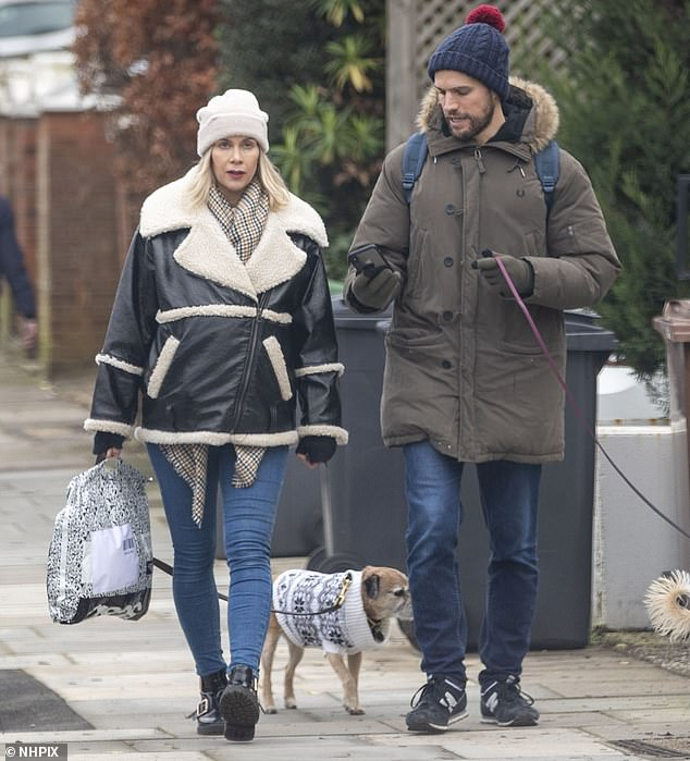 Radiant: Pregnant Kate Lawler looked radiant as she enjoyed a relaxing stroll with her fiancé Martin and their two pet dogs - Baxter and Shirley - in London on Monday