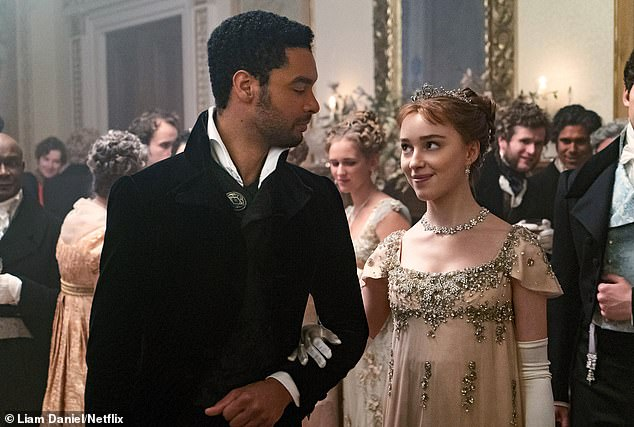 The plot follows central protagonist Daphne Bridgerton (Phoebe Dynevor) on London's matchmaking scene; Daphne pictured with the Duke of Hastings (Regé-Jean Page)