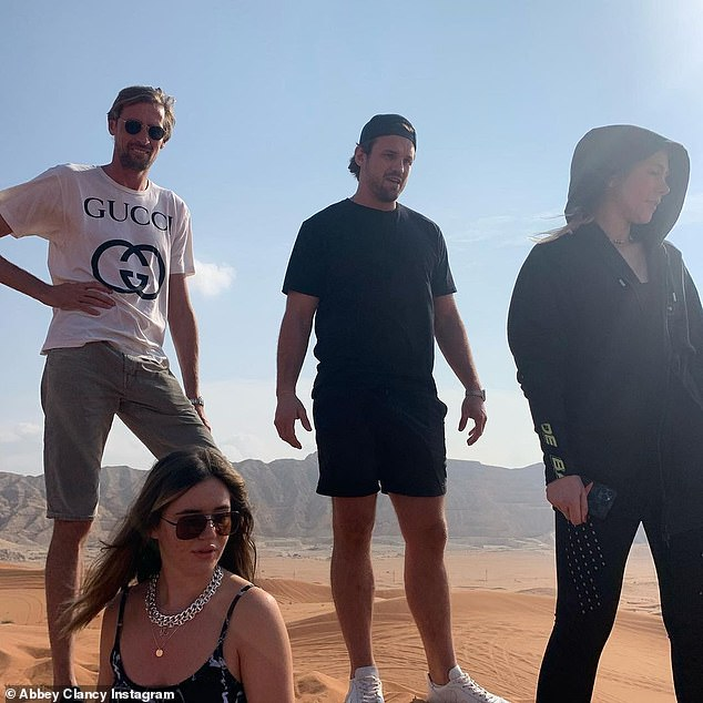 Friends:For one of the photos, Peter, 39, posed with friends and family during the trip