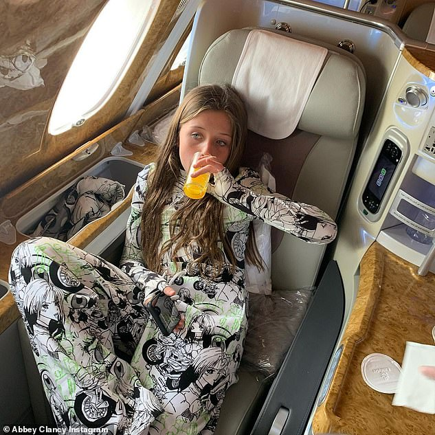 Luxury:While a different snap saw eldest child Sophia sipping an orange juice while sitting in first class on an aeroplane