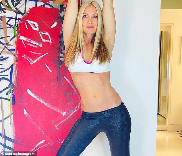 Fighting fit: Caprice Bourret showed she's fighting fit, as she took to Instagram to share sizzling snaps of her incredibly toned physique on Tuesday morning