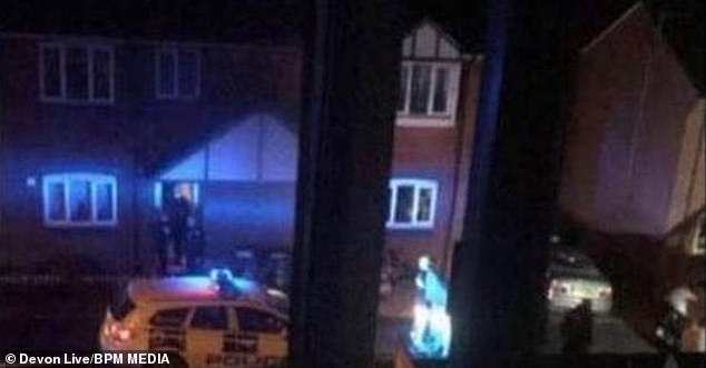 A 51-year-old woman has been arrested for murder after her husband was found stabbed to death in their home (pictured: police at the property on Tennyson Way on Sunday)