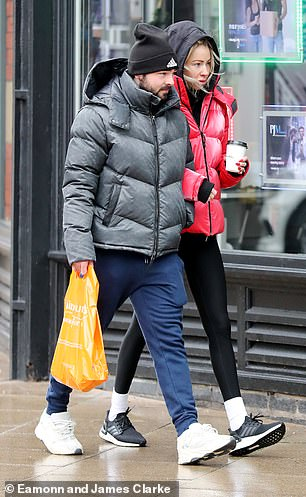 Shop:Olivia looked stylish in a scarlet jacket, worn over a black hoodie
