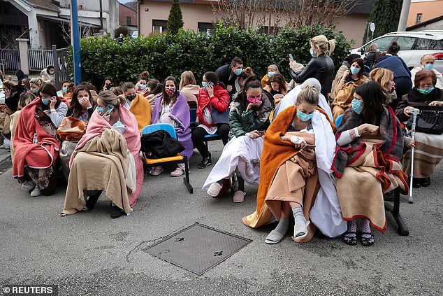Patients and medical staff are evacuated outside the Sveti Duh Hospital after an earthquake in Zagreb, Croatia