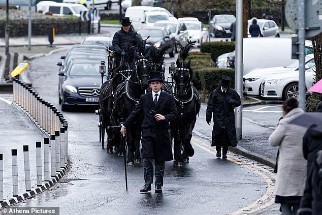 A horse drawn carriage pictured arriving at St Tydfil's Old Parish Church.People lined the streets to say farewell to the hospital nurse ahead of her funeral today