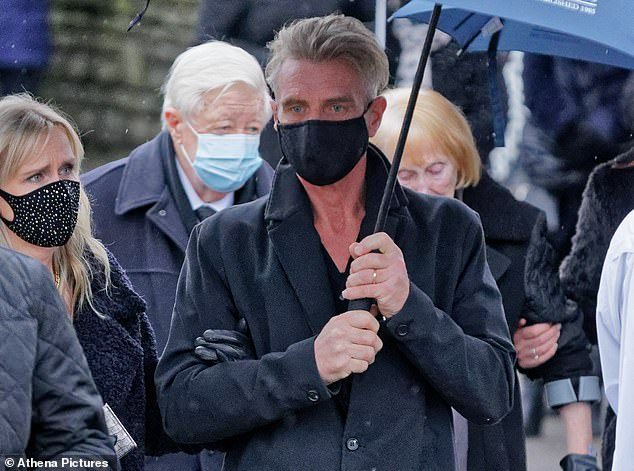 Jayne's husband Rob, 56, arriving at St Tydfil's Old Parish Church in Merthyr Tydfil, Wales, today. Jayne'took her own life' after struggling to cope when she lost three limbs to sepsis