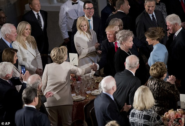 President Trump shakes hands with Hillary Clinton as he and Melania arrive at his luncheon in January 2017