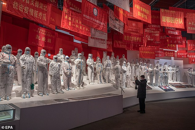 Life in the city of 11 million people, which was the original epicentre of the pandemic, is slowly returning to normal. Pictured: A man visits an exhibition called People First, Lives First about China's Covid-19 response at the Culture Expo Centre, which used to be a makeshift hospital in Wuhan, China