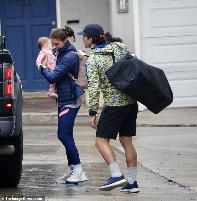 Family time: The 31-year-old Women's World Cup winner went for a donut and coffee run on a rainy Monday morning in LA, bringing along her hubby and seven-month old baby, Charlie