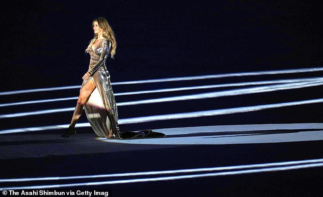 What a moment: Back in August 2016, Gisele - who is a native of Brazil - walked down the 'runway' at Maracana Stadium to The Girl from Ipanema performed on the piano by Daniel Jobim
