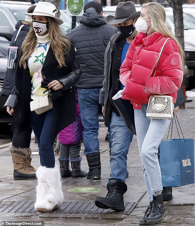 Only the best:The 45-year-old showed her fondness for brand names on her latest outing, teaming a Chanel mask with an Yves Saint Laurent bag