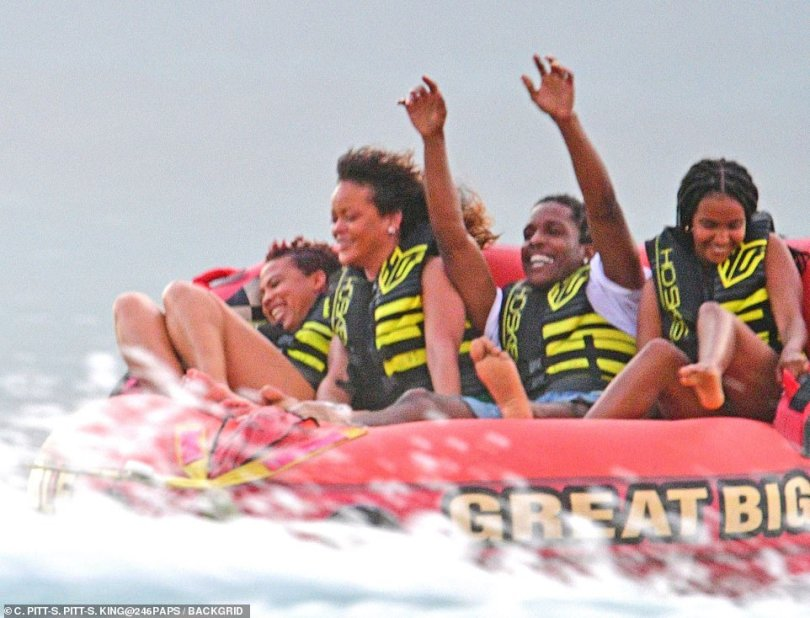 Sweet: The two even sat next to each other as they hopped on a four-person rider tube called the Sportsstuff Great Big Mable on the water