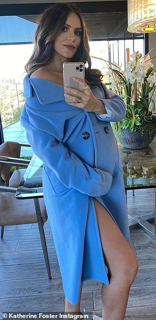 It's a boy? She appeared to hint that she's having a boy, not only with the color of the coat, but with a blue butterfly emoji framed by two blue heart emojis in the caption
