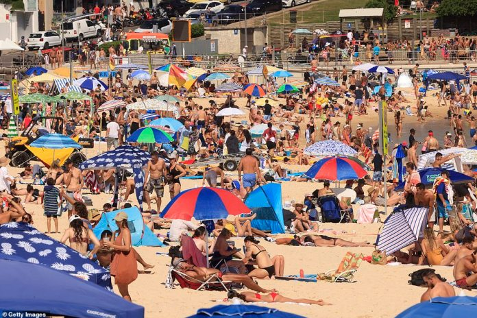 Premier Gladys Berejiklian has tightened restrictions ahead of New Year's Eve. Pictured: Bondi Beach on Sunday