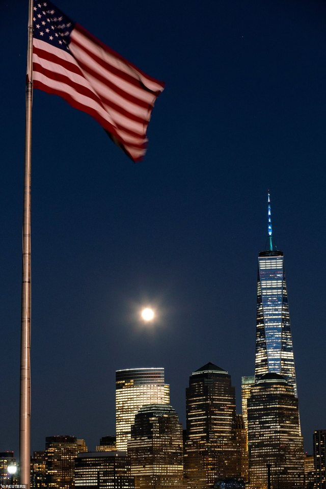 The full moon easily competes with some of the bright lights of the Financial District in New York City