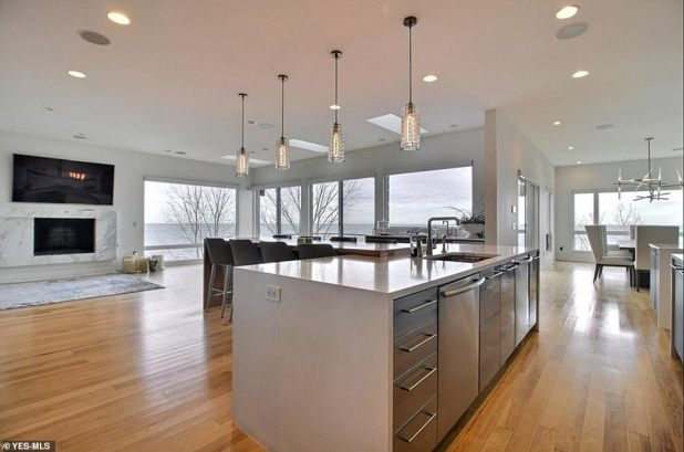 Spacious: The house has an open plan dining room and kitchen with a large dining table