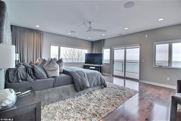 WOW: The Star's grand waterfront residence is a walk-out entertainment level with five bedrooms, a full theater, full bar, billiards and poker, and a wine cellar.
