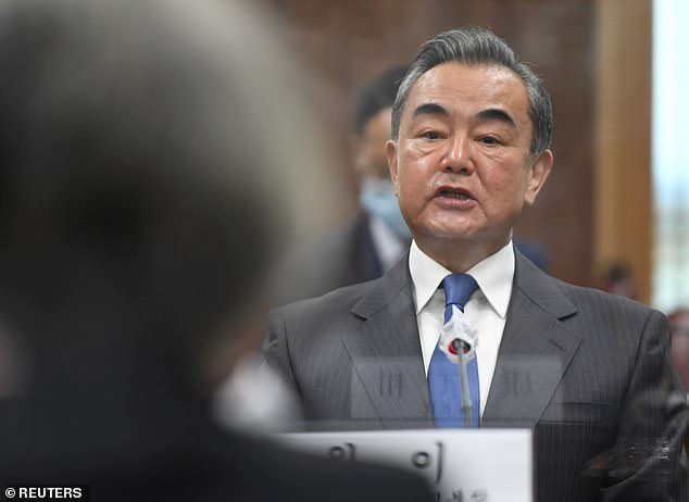 Chinese Foreign Minister Wang Yi (pictured in November) has hinted at a possible reconciliation between Beijing and Australia after months of hostility