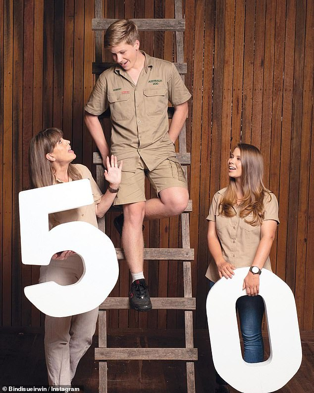 Nightmare year: Bindi Irwin candidly spoke out about the struggles her family faced in 2020 in an emotional statement online in December. Pictured: Bindi with brother Robert and mother Terri, who celebrated 50 years of Australia Zoo last year