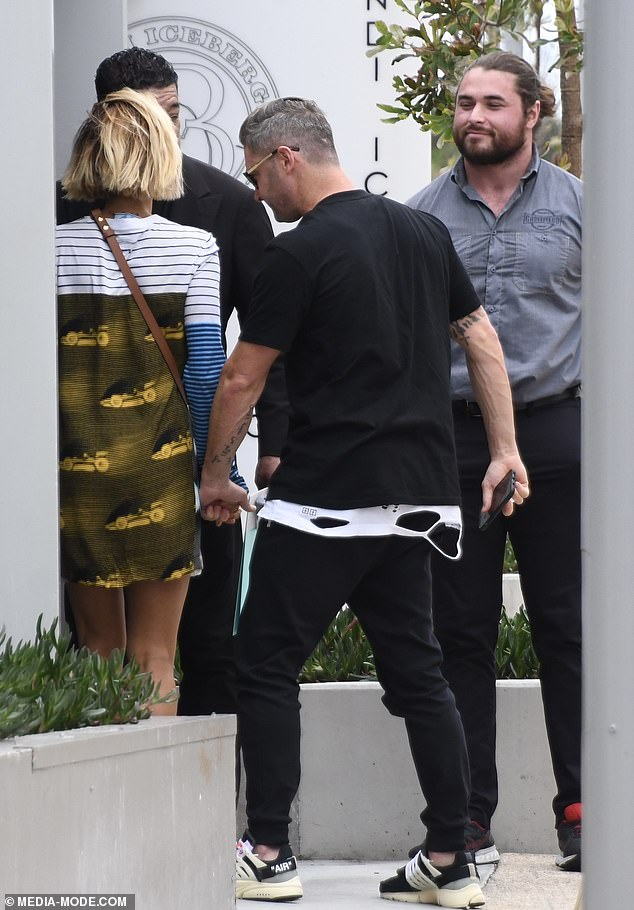 Accessories: Michael completed the ensemble with a pair of black sneakers and wore sunglasses as he arrived to Bondi Icebergs Club