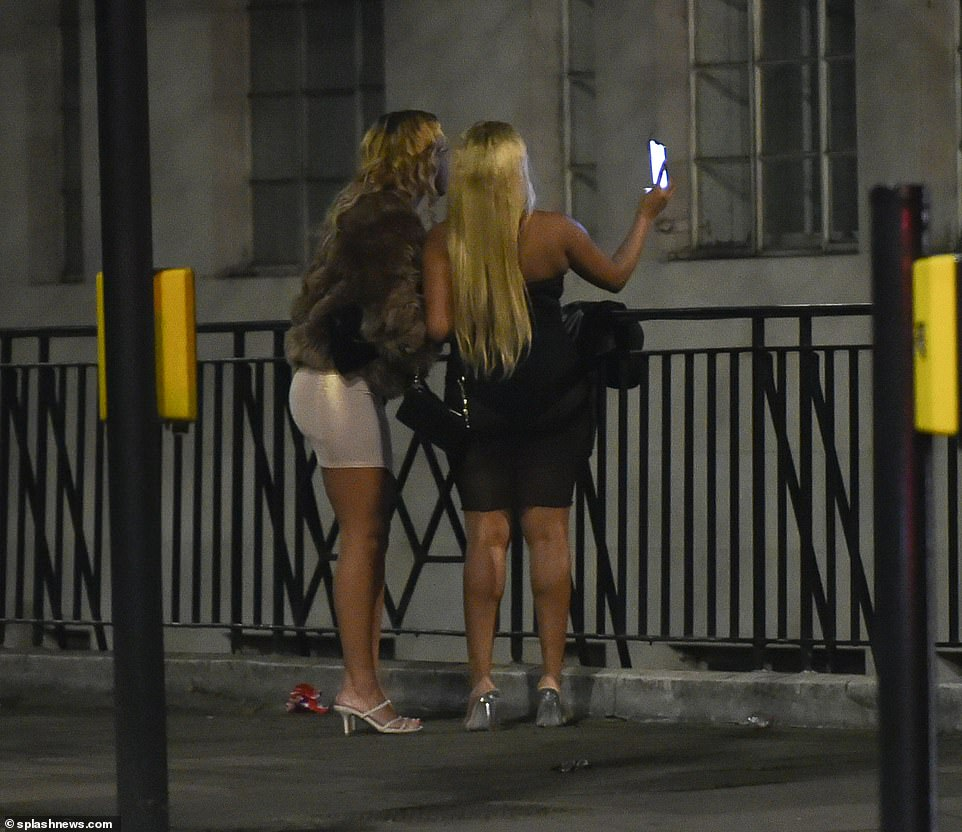There were revellers out in Kensington, West London, last night, as two people were spotted stopping for a selfie on their way out for New Year's Eve